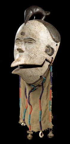 Africa | Mask from the Ogoni people of Nigeria | Wood, kaolin, fabric, glass beads, cowrie shells and brass bells