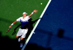 John Isner of United States of America serves to Filippo Volandri of Italy during their first round men's singles match on Day Two of the 2013 US Open at USTA Billie Jean King National Tennis Center on August 27, 2013 in the Flushing neighborhood of the Queens borough of New York City
