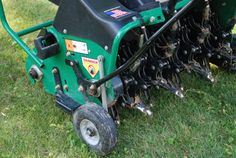 core aerating the lawn - Give your lawn a boost by core aerating away problems like compacted soil and thatch...