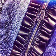 Salmonleatherjacket detail and our kiss logo. #leatherjacket #ruffles #zipper