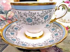 TUSCAN TEA CUP AND SAUCER BLUE & FLORAL PAINTED TEACUP PATTERN GOLD GILT