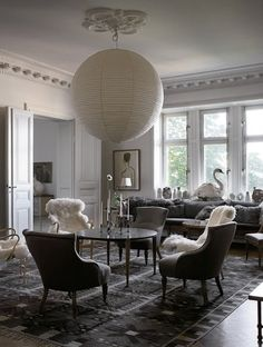 Gray tones, lots of light, low comfy dining chair, beautiful rug, very large lantern over table. divine South Shore Decorating Blog