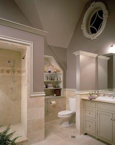 Master Bathroom, light purple walls, cream stone floor & shower and light gray cabinets.