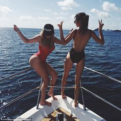 Khloe and Kendall flaunt family's famous curves in one-piece swimsuits #dailymail