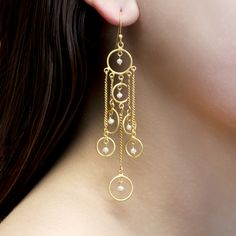 The Nelly Earrings are comprised of gold vermeil loops and chains, dotted with seed pearls.