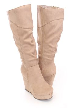 Stay warm and stylish with these adorable wedge boots! You could dress them up with your favorite dress or keep it casual with your favorite skinnies. Make sure you add these to your closet, it definitely is a must have! The features include a faux suede upper with a slouchy design, round closed toe, stitched detailing, inner side zipper closure, smooth lining, and cushioned footbed. Approximately 4 1/2 inch wedge heels, 1 1/2 inch platforms, 14 inch circumference, and 13 inch shaft.