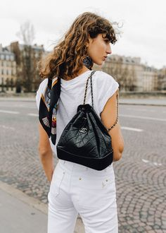 Read Model-Off-Duty Style With Roberta Pecoraro on CHRONICLES OF HER - white on white t-shirt and denim, CHANEL Gabrielle bag and tousled, textured, curly, bed hair.