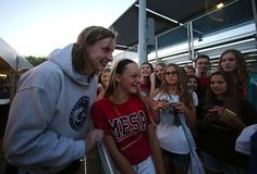 Katie Ledecky Photos - Katie Ledecky poses for a photo with a fan after day one of the Arena Pro Swim Series at the Skyline Acquatic Center on April 2015 in Mesa, Arizona. - Arena Pro Swim Series at Mesa - Day 1 Katie Ledecky, Olympic Swimmers, American Legend, Olympics, Photos, Pictures