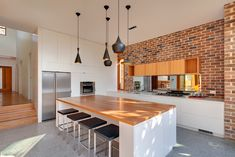 grey kitchen with bare brick wall - Google Search