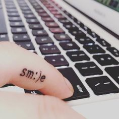 pinterest || ☽ @kellylovesosa ☾How adorable is this smile tiny finger tattoo