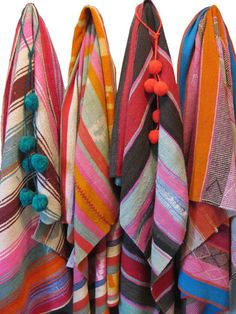 These one-of-a-kind vintage throws also known as mantas, aguayos, or frasadas are from Argentina. Each one is vegetable dyed in unique colors and patterns. Use them as floor rugs to brighten up your outdoor patio or wrap them around chairs or bench cushions.
