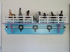"A safe place to display your model horse collection.  All hand made in Texas out of solid wood.  Size is 48"" x 12"" x 12"" , $99.95 plus shipping.  Find us on Facebook Shelf Stables for more colors and contact information."
