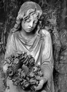 Wreath of Roses, Statue in cemetery in Baden Wurthenberg, Germany.