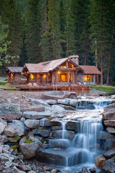 Rustic Cabin With Pond and Waterfall. I would imagine this is the way the land slopes, but would have preferred the waterfall to face the house as a view from inside. Swimming Pool Waterfall, Swimming Pools, Style At Home, Beautiful Homes, Beautiful Places, House Beautiful, Amazing Places, Amazing Photos, Beautiful Houses Interior