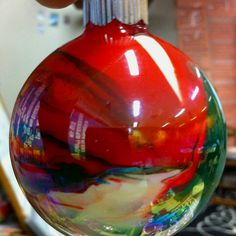 Super easy Christmas ornaments: All you need are the clear balls and acrylic paint. Drip a tiny bit of your chosen colors, turn to let the paint run to the bottom, and lay aside to turn again tomorrow and the day after that and the day after that. When you think it's dry (days later), turn it upside down and leave it for excess paint to run out. They're unique and beautiful.