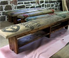 Reclaimed Wood Bench with Coffee Sack upholstery. I feel like this could be a DIY project someday!