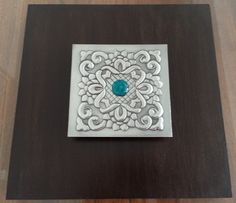 Design done By Grace on wooden canvas with glass bead. No texture was used in this piece, but polished beautifully to bring out the design.