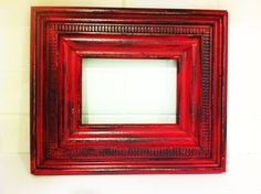 picture frame made from crown moulding with distressed two-tone paint finish