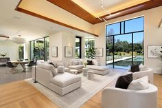 Beautiful modern living room with a large window overlooking the pool ATHERTON San Mateo County CA [1440x960] http://ift.tt/2bn3jhY