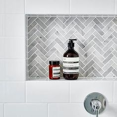 White subway tiles frame a gray marble herringbone tiled shower niche.Another niche idea. White subway tiles frame a gray marble herringbone tiled shower niche. Tiny House Bathroom, Bathroom Renos, Laundry In Bathroom, Bathroom Remodeling, Remodeling Ideas, Subway Tile Bathrooms, Bathroom Marble, Subway Tile Showers, Accent Tile Bathroom