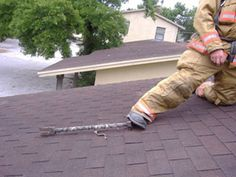 Using the haligan for a footing while venting the roof.