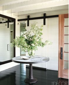 I love this kind of round table (darker wood) for foyer and/or entry way with flowers.