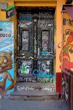A door covered with graffiti as it can be found often in Berlin.