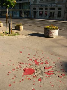 Sarajevo Roses – Painful War Memories Etched in Asphalt