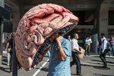 Sao Paulo, Brazil: A man uses a public phonebooth decorated as a brain. Photograph: Yasuyoshi Chiba/AFP/Getty Images