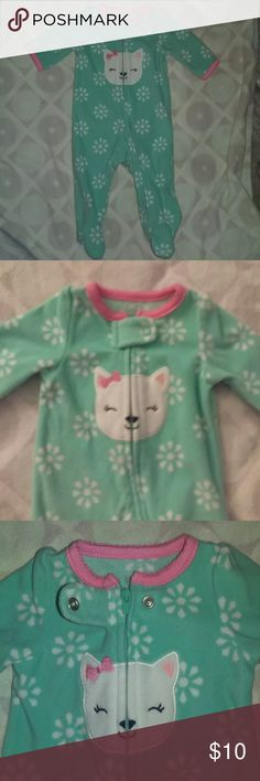 Baby girl onsie Is a baby blue/teal color. Has a kitty design in the middle front, and white flowers all over. Has a zipper as closure. Very clean and soft. Carter's One Pieces Footies