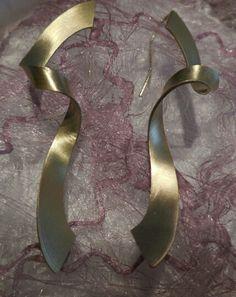 Orecchini stelle filanti in oro by Sabrina Bottura