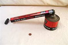 Vintage Tin Black Flag Garden Bug Sprayer...Mom would spray house and barn with one of these.  We'd have to stay out of the house for a period of time.  I had the job of sweeping up dead flies in the house !  :)
