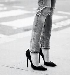 destroyed denim and black heels