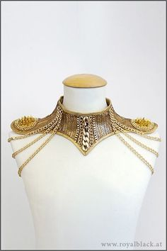 """treasures-and-beauty:"""" Pure Gold Neck Corset by Royalblack Glamourous neck corset made from golden sequin fabric. It is decorated with golden chains and mini epaulettes with spikes, Swarovski crystals and shoulder chains. Sequin Fabric, Mode Style, Dance Costumes, Costume Design, Body Jewelry, Jewellery, Wearable Art, Ideias Fashion, Swarovski Crystals"""