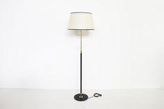 Lunel Floor lamp  https://www.galerie44.com/collection/luminaires/lampadaire-ajustable-metal-laque-noir-et-laiton-edition-lunel-1950-details