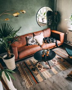 20 Top Design Ideas For A Small Living Room. 20 Top Design Ideas For A Small Living Room. A living room is the most essential part of a household. It depicts the personalities of the people staying in […] Boho Living Room, Interior Design Living Room, Home And Living, Earthy Living Room, Green Living Room Walls, Brown And Green Living Room, Living Room With Plants, Small Living Room Designs, Living Room Wall Ideas