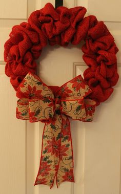 "Christmas Wreath made with Red Burlap Ribbon with Bow.  Measures approx. 16"". Find me on facebook at www.facebook.com/southernhomewreathsandart"