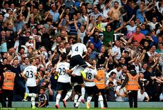 Pure joy: The Tottenham players run over to celebrate with their jubilant fans after Dier's late winner