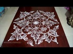 easy rangoli design rangoli design video youtube youtube muggulu best rangoli design indian rangoli - YouTube Small Rangoli Design, Rangoli Kolam Designs, Kolam Rangoli, Beautiful Rangoli Designs, Rangoli With Dots, Simple Rangoli, Ear Rings, Diwali, Saree