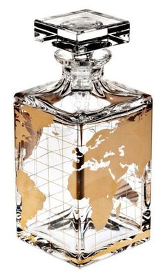 Atlas Lead Crystal Spirits Decanter OSCAR DE LA RENTA A golden world-map overlay illuminates a clean-lined crystal decanter hand-blown in Portugal—perfect for serving your favorite whiskey in cosmopolitan style # Decanter