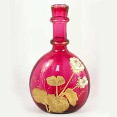 A spectacular century art glass decanter for table service of wine, water, or just to display, this cranberry glass carafe is tall and will