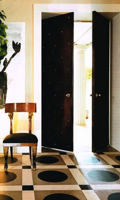 Entry/Foyer - The door, the chair and yes, the floor - all gorgeous.