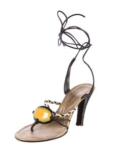 Black and tan leather Costume National sandals with enamel accent at topline, grooved stacked heels and ankle tie closures.