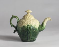 STAFFORDSHIRE CREAMWARE CAULIFLOWER PATTERN TEAPOT AND COVER, CIRCA 1760-70.