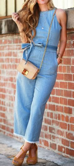 Florida fashion blogger styles a 70s inspired outfit with a denim culotte jumpsuit, suede platform sandals, and gold accessories
