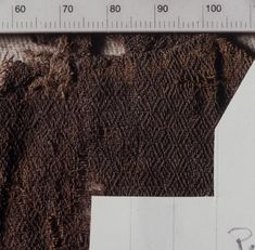 Diamond twill weave fabric from the Oseberg burial, in the Kulturhistorik Museum, Norway.