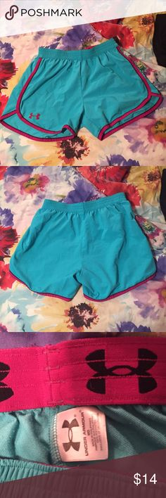 Under Armour Shorts Under Armour shorts in size medium. Turquoise shorts with magenta accents. Foldable Under Armour logo waistband. Under Armour Shorts