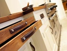 """Pin description says: """"17 Ingenious Ways Of Reusing Old Leather Belts"""" - wether its a belt or not, these leather drawer pulls are just super cool."""