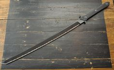 Titanium / Carbon Fiber Sword (Carbon fiber with a blade of Titanium in the center)