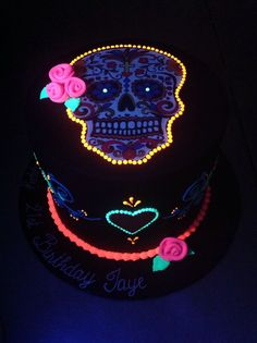 Day of the Dead, skull, Halloween theme cake - Double hight Kahlua mud cake, black fondant iced with Day of the Dead Skull themed cake with fluorescent glowing fondant and royal icing details